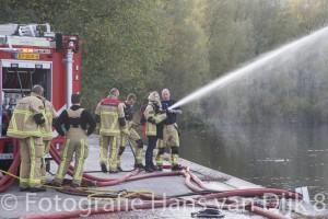 Brandweer Amsterdam aan de Sloterplas voor een radio reportage van de KRO-NCRV